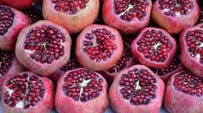 Pomegranate slices. Close-up of ripe organic pomegranate (Punica granatum) fruit on display Stock Photos