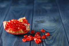 Pomegranate slices and garnet fruit seeds on table. Selective fo Stock Photography