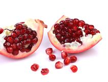 Pomegranate slices isolated on a white backgrount Stock Photography