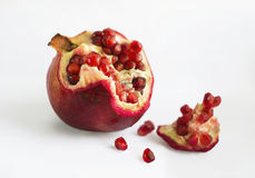 Pomegranate slices and seeds, pomegranate fruit on white background Royalty Free Stock Image
