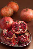 Pomegranate slices and seeds on silver tray Royalty Free Stock Image