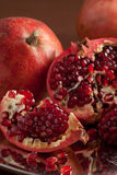 Pomegranate slices and seeds on silver tray Royalty Free Stock Images