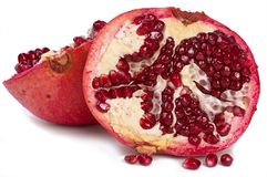 Pomegranate slices on white background Stock Images