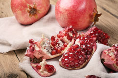 Pomegranate slices on a wooden table closeup Stock Image