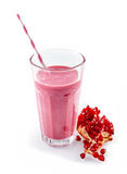 Pomegranate smoothie with straw next to fruit Stock Photos
