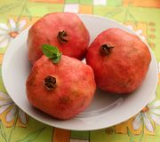 Pomegranate. Some red, exotic pomegranate on a plate stock image