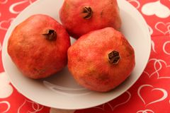Pomegranate. Some red, exotic pomegranate on a plate royalty free stock image