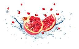 Pomegranate splash Stock Photos