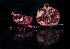 Pomegranate and spoon Royalty Free Stock Photos