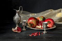 Pomegranate and stemware with liqueur stock photo