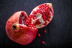 Pomegranate on a stone plate. Fresh pomegranate placed on a stone plate Stock Photos