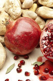 Pomegranate with stones. On a wooden tray royalty free stock image