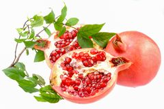 Pomegranate sweet friut. With leaves royalty free stock image