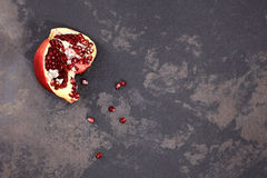 Pomegranate on the table Stock Images