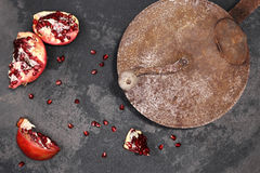Pomegranate on the table with old pot Royalty Free Stock Images