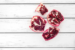 Pomegranate on table Stock Images
