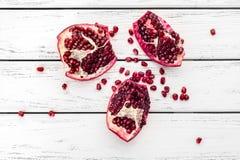 Pomegranate on table Stock Photos