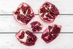 Pomegranate on table Royalty Free Stock Photo