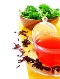 Pomegranate tea, greens and a lemon. Royalty Free Stock Photo