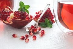 Pomegranate tea and pomegranate seeds on white royalty free stock image