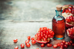 Pomegranate tincture or juice and garnet fruit stock photo