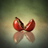Pomegranate. Two halves of a pomegranate on the table stock photo