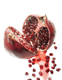 Pomegranate in two pieces. Pomegranate cut in two pieces with seeds and juice stock images