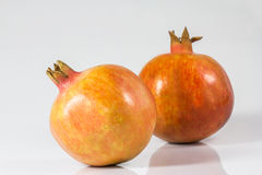 Pomegranate. Two pomegranates on a white background Stock Photo