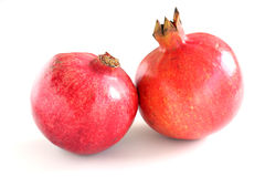 Pomegranate. Two pomegranates on a white table stock photo