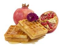 Pomegranate, violet, waffle Stock Photos