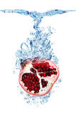 Pomegranate in water Stock Images