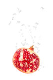 Pomegranate in water with air bubbles Stock Photography
