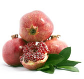 Pomegranate on the white background. Ripe pomegranates with leaves on a white background stock photo