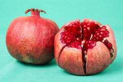 Pomegranate on white background. Two pomegranates placed on green background royalty free stock photography