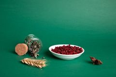 Pomegranate in a white bowl with wheat stock images