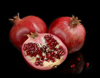 Pomegranate whole and open-face with seeds Stock Photos