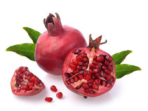 Pomegranate whole and open-face Stock Images