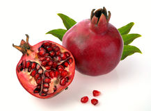 Pomegranate whole and open-face Stock Photo