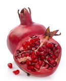 Pomegranate whole and open-face with seeds Stock Images
