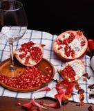 Pomegranate and wine Stock Image