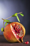 Pomegranate on wood Royalty Free Stock Images