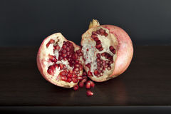 Pomegranate on Wood Table Royalty Free Stock Photos