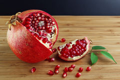 Pomegranate on wood table Stock Photo