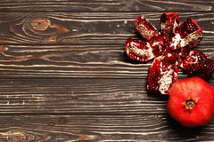 Pomegranate on wooden background stock images