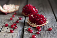 Pomegranate on wooden boards Stock Images