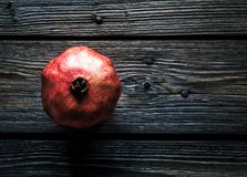 Pomegranate on a wooden rustic background. fruit, food, look for useful stock image