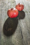 Pomegranate on wooden table Stock Photo