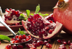 Pomegranate on the wooden table Royalty Free Stock Photo
