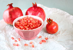 Pomegranate on wooden table, and fresh pomegrante seed in bowl Stock Images