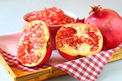 Pomegranate on wooden table, and fresh pomegrante seed in bowl Stock Photo